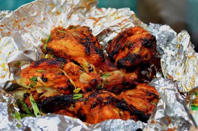 Can You Put Aluminum Foil In An Air Fryer?- a roasted chicken wrapped up in aluminium foil